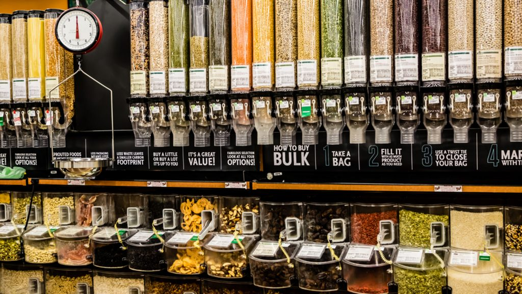 A large selection of bulk dry foods in clever dispensers and a weighing scale at an upscale grocery store; Shutterstock ID 131422709; PO: today.com